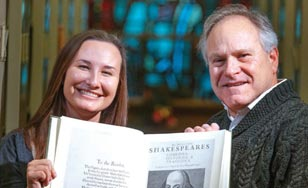 Maddie Swenson and Tom Zelman, Ph.D., holding a collection of Shakespeare