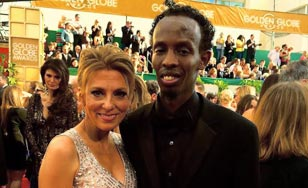 DeLisi escorting best supporting actor nominee Barkhad Abdi to the Golden Globes