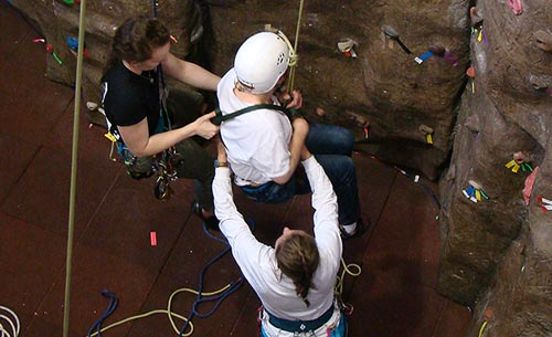 Annalisa getting Courage Kenny participant Joe Kent ready to assend the climbing wall.