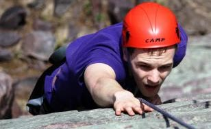 Student climing a cliff.
