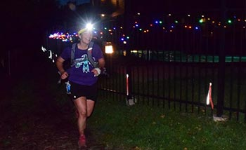 Alicia Cyr running in a 52-mile ultramarathon