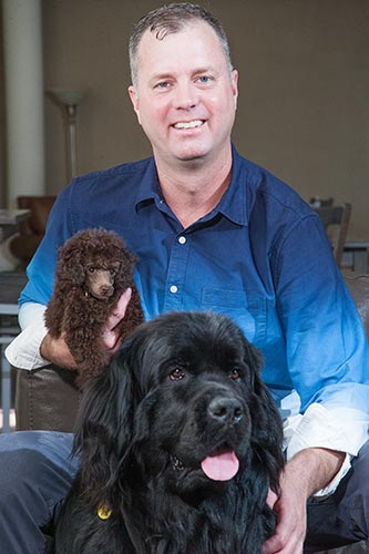 Lee with his two therapy dogs, Nova and Prince Louis