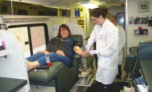CSS staff member Tiffany Snider makes a donation during a campus blood drive on June 25.