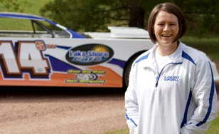 Race car driver, Tiffany Hudack, standing by her car