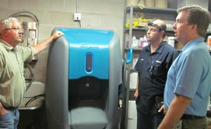 Photo of St. Scholastica staff with new water treatment processing unit.