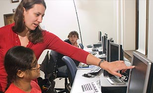 Jennifer Rosato working with students in computer lab.