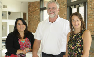 Paula Tracey, St. Scholastica Social Work;  Mike Kongsjord, HDC's IT director; and Brooke Palkie, St. Scholastica HIIM