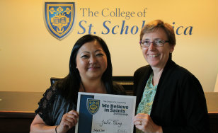 Scholarship winner Julie Vang, left, with St. Paul campus director Amy Grimm