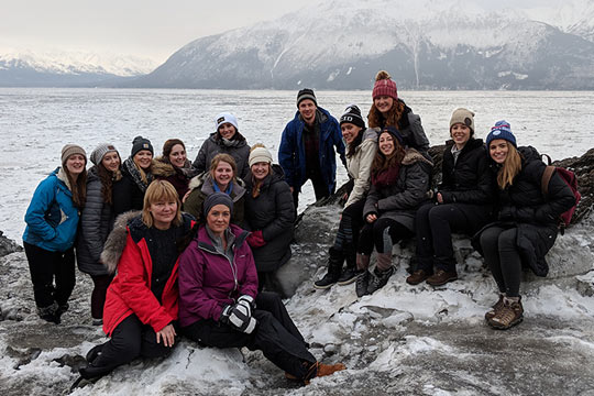 Andrea Simek RN, DNP, Assistant Professor and Paula Byrne RN, DNP, Assistant Professor with Christina Jacobson '19  and other students at Beluga Bay on Turnagain Arm, Alaska. (2019)