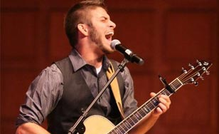 Preston Gunderson performing in the Mitchell Auditorium
