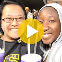 Two students enjoying a student gathering on campus