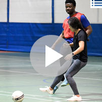 Video playlist image - two students playing soccer