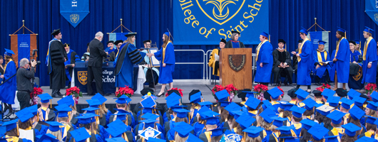 CSS students receiving their diplomas at commencement