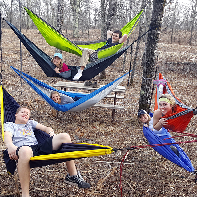 Five Students in hammocks