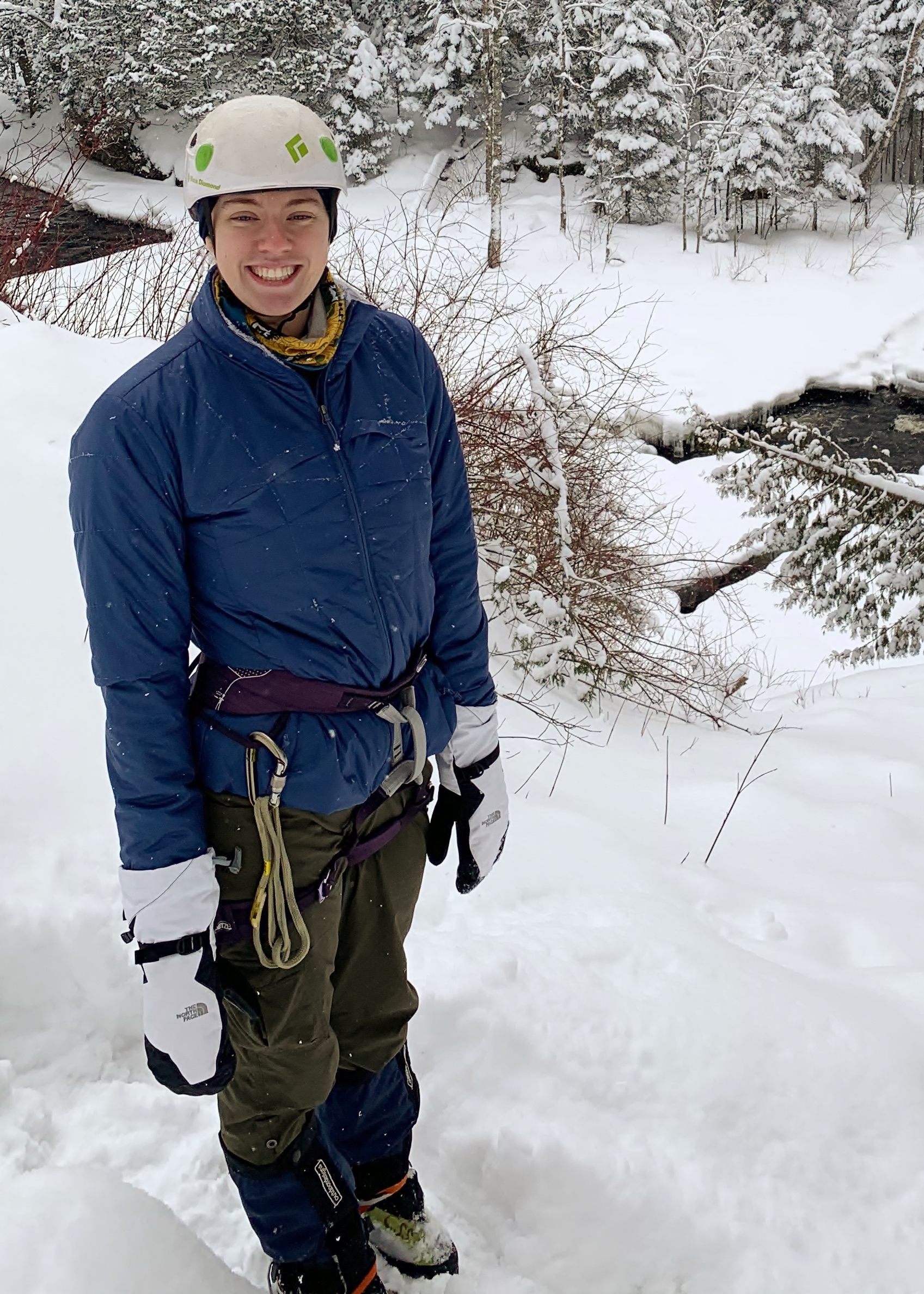 Katlyn in climbing harness and helmet along the cascade river