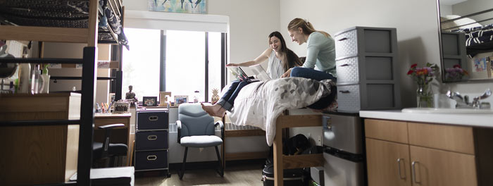 Two students in their room in Somers's Hall at St. Scholastica