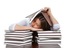 woman sleeping on a pile of books