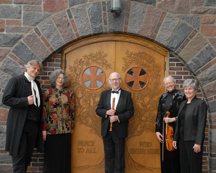 Music Department Faculty in front of Peace doors.
