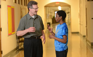 Academic adviser talking to a student