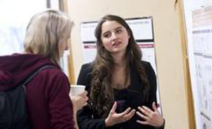 Two students talking about research
