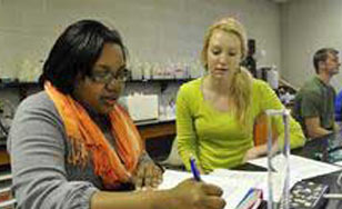 Two students talking in Chemistry lab