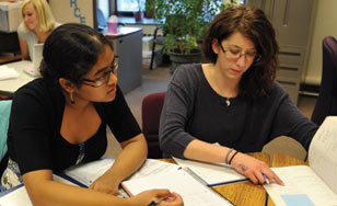 Tutor assisting a student in the tutoring center