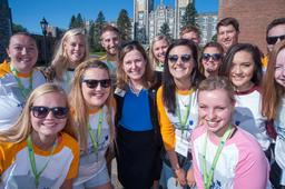 group of students with Pres. Geary smiling with sunglasses