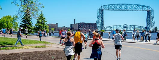 Grandma's Marathon runners near the Lift Bridge in Duluth, MN