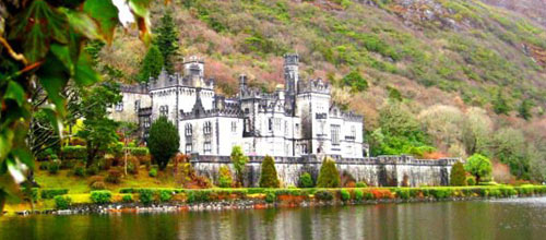 Kylemore Abbey castle near a lake in Ireland