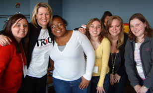 Five alumni students with the TRIO program director