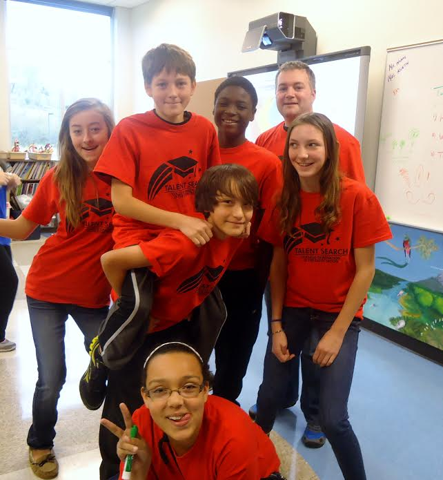 Group of happy students in red