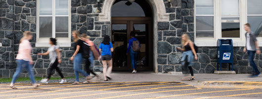 a photo of the north entrance of tower hall with students walking about