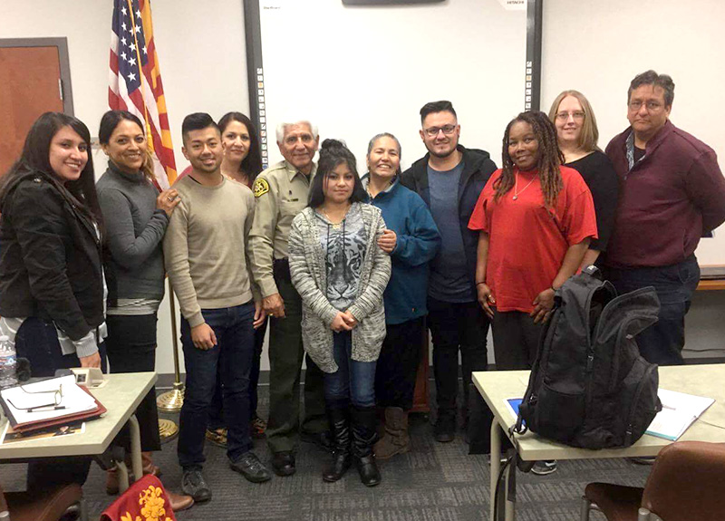 Social work students visit with Santa Cruz County Sheriff Tony Estrada.