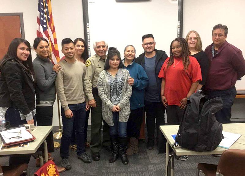 Social work students visit with Santa Cruz County Sheriff Tony Estrada.