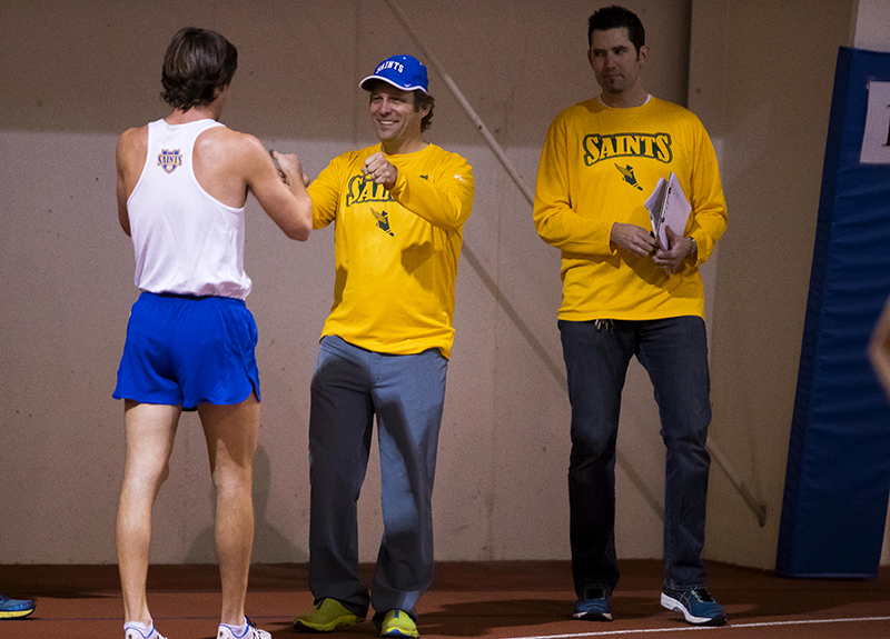 Coach Salmela, center, works with some cross-country athletes.