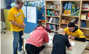 Saints baseball players volunteered at Pike Lake Elementary.