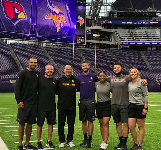 David Kimmer (center, in purple) with his fellow AT interns and Head Athletic Trainer Eric Sugarman (third from left).